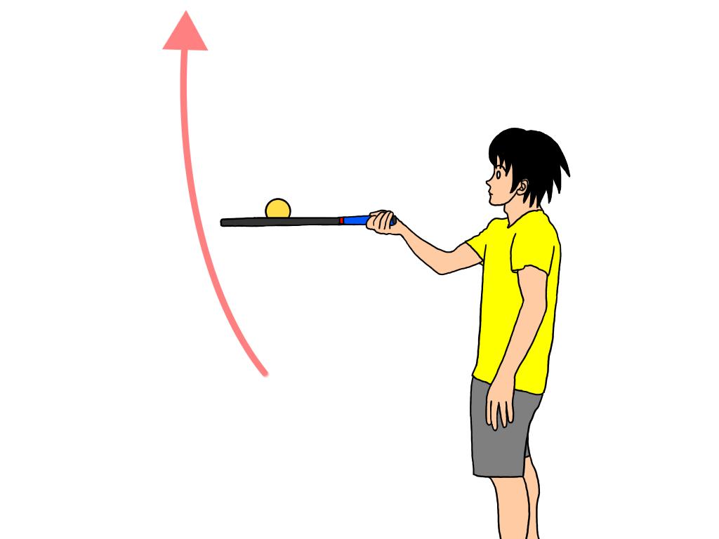 高く上げたボールをラケットでキャッチする